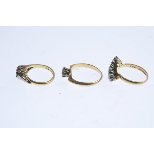 329 - Three 18ct gold diamond rings. To include a mid 20th century diamond single-stone ring, a diamond si...
