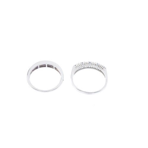 33 - Two 18ct gold diamond and gem-set half-circle eternity rings. Each of alternating design, the first ...
