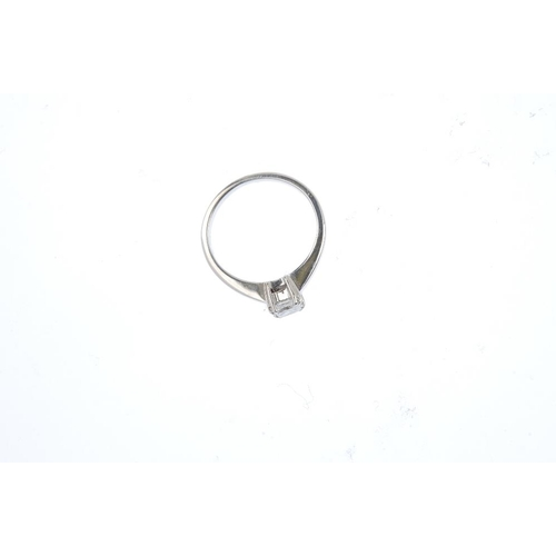 332 - A 18ct gold diamond single-stone ring. The square-shape diamond, with tapered shoulders. Diamond wei...