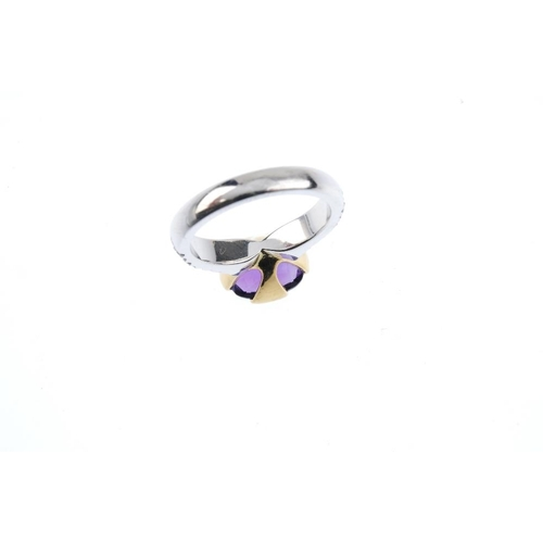 334 - An 18ct gold sapphire and purple gem dress ring. Designed as an oval-shape amethyst, with pave-set p...