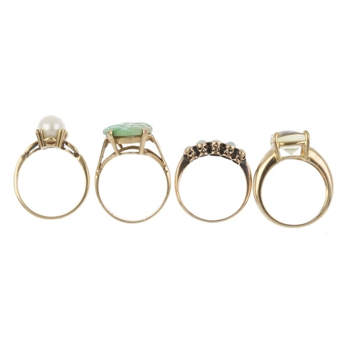335 - Four 9ct gold gem-set rings. To include an early 20th century opal cabochon five-stone ring, a later...