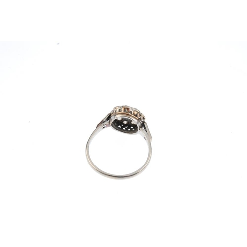 336 - A diamond cluster ring. The old-cut diamond, with similarly-cut diamond surround and single-cut diam...