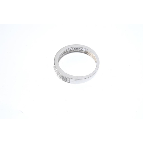 337 - An 18ct gold diamond band ring. The brilliant-cut diamond curved panel, and tapered band. Estimated ...