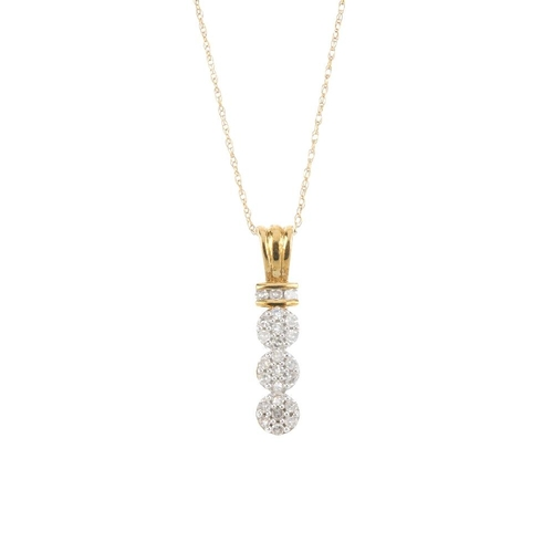 339 - A 9ct gold diamond pendant. Comprising a single-cut diamond triple cluster line, with similarly-cut ...