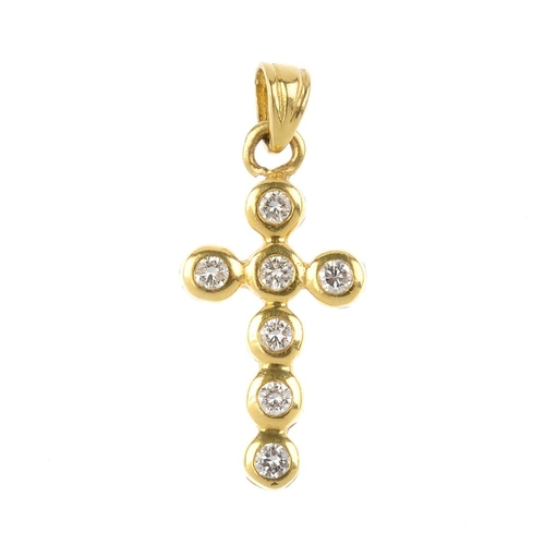 35 - An 18ct gold diamond cross pendant. Designed as a series of brilliant-cut diamond collets. Estimated...