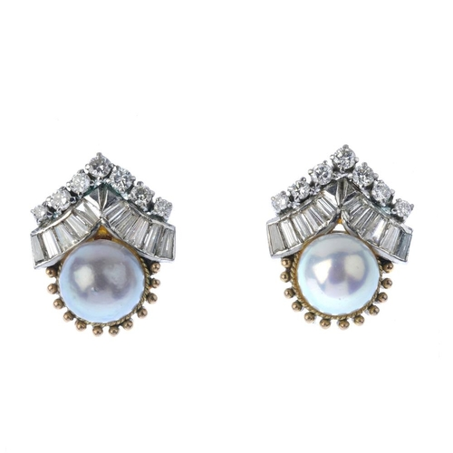 351 - A pair of diamond and cultured pearl stud earrings. Each designed as a cultured pearl, measuring app...