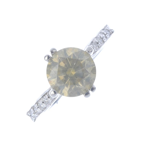 353 - A coloured diamond single-stone ring. The brilliant-cut 'slightly brownish, greenish-yellow' diamond...