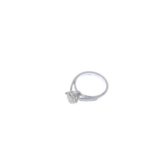353 - A coloured diamond single-stone ring. The brilliant-cut 'slightly brownish, greenish-yellow' diamond...