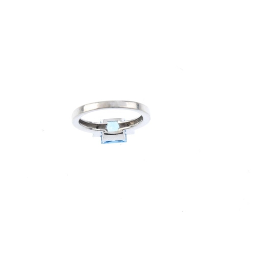 355 - An 18ct gold topaz and diamond three-stone ring. The square-shape blue topaz, with brilliant-cut dia...