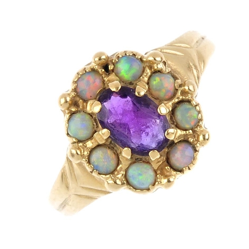356 - Four 9ct gold gem-set rings. To include a ruby panel ring, an amethyst and opal cluster ring, an ame...