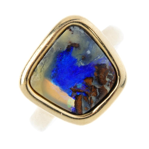 358 - A 9ct gold boulder opal single-stone ring. The free-from boulder opal, within a collet setting, to t...