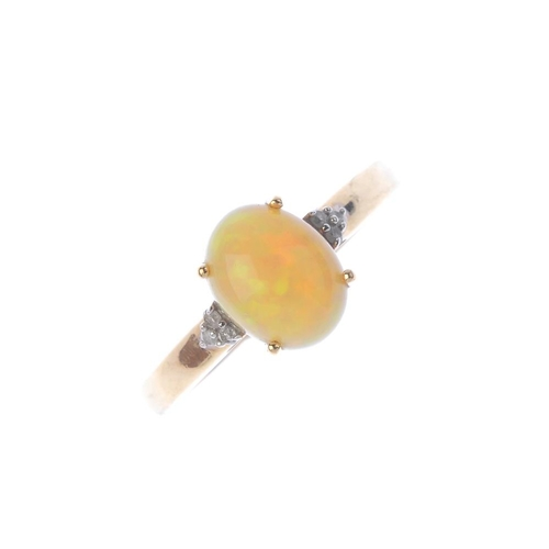 360 - A 9ct gold opal and diamond ring. The oval opal cabochon, with brilliant-cut diamond trefoil sides a...