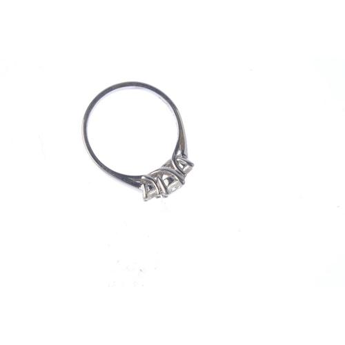 363 - A 14ct gold diamond three-stone ring. Designed as a graduated brilliant-cut diamond line. Estimated ...