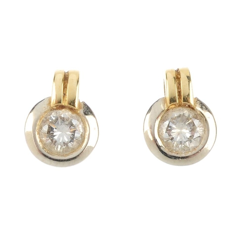 375 - Two items of 18ct gold diamond jewellery. Each of bi-colour design, the pendant designed as a brilli...