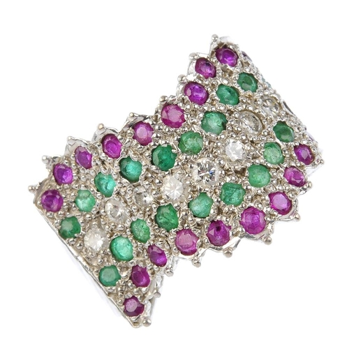 379 - A diamond, ruby and emerald dress ring. Designed as a series of brilliant-cut diamond and circular-s...