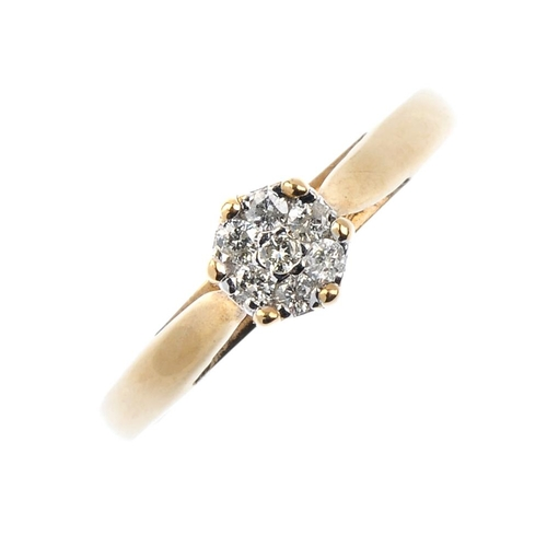 38 - A 9ct gold diamond cluster ring. The brilliant-cut diamond, with similarly-cut diamond surround. Tot...