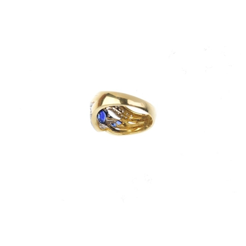 383 - An 18ct gold sapphire and diamond dress ring. Of bi-colour design, the oval-shape sapphire collet, w...