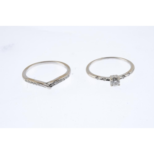 384 - Two 18ct gold diamond dress rings. The first designed as a brilliant-cut diamond with similarly-cut ...