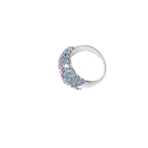 386 - A diamond, sapphire and topaz dress ring. The brilliant-cut diamond and circular-shape pink sapphire...