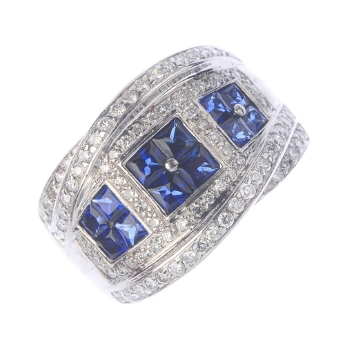 39 - An 18ct gold sapphire and diamond dress ring. Comprising three graduated square-shape sapphire quatr...