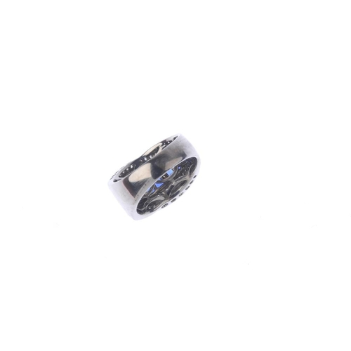 39 - An 18ct gold sapphire and diamond dress ring. Comprising three graduated square-shape sapphire quatr...
