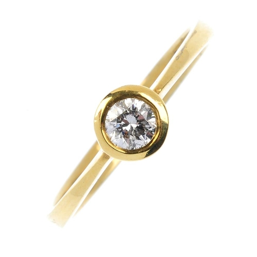 390 - An 18ct gold diamond single-stone ring. The brilliant-cut diamond, with tapered shoulders. Diamond w...