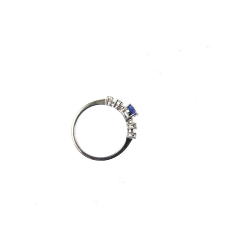 4 - An 18ct gold sapphire and diamond ring. The oval-shape sapphire, with baguette and brilliant-cut dia...