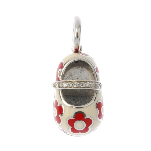 400 - An 18ct gold diamond and enamel charm. The cream and red floral shoe, with brilliant-cut diamond lin...