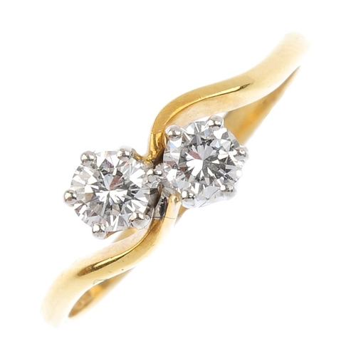 402 - BOODLES - an 18ct gold diamond crossover ring. The brilliant-cut diamond crossover, with asymmetric ...