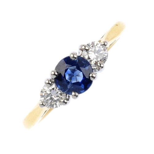 403 - BOODLES - an 18ct gold sapphire and diamond ring. The circular-shape sapphire, with brilliant-cut di...