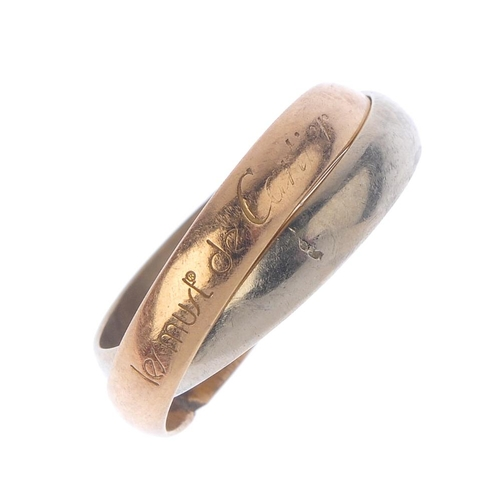 406 - CARTIER - a 'trinity' band ring. Designed as two bi-colour entwined band. AF. Signed les must de Car...