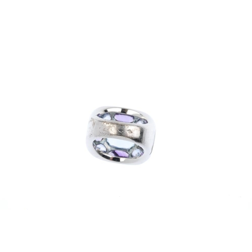 407 - CHANEL - an aquamarine and amethyst dress ring. The rectangular-shape aquamarine, within a vari-shap...
