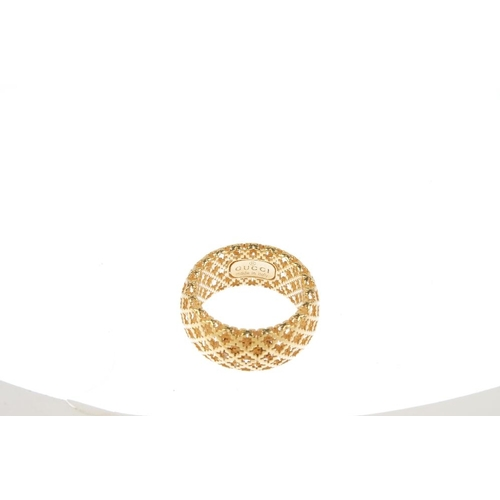 412 - GUCCI - an 18ct gold 'Diamantissima' ring. Designed as an openwork lattice band. Signed Gucci. Hallm...