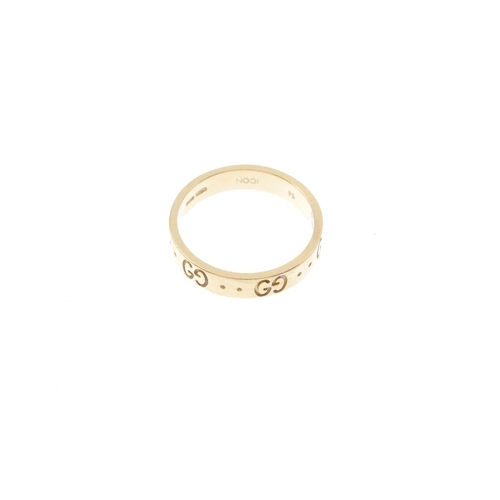 414 - GUCCI - an 'Icon' band ring. Designed as a repeating series of double 'G ' and dimple motif, to the ...