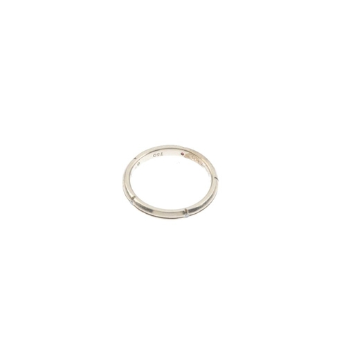 418 - TIFFANY & CO. - a diamond band ring. The plain band, with grooved lines and diamond accent intersect...