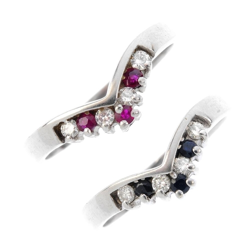 42 - Four diamond and gem-set rings. To include a 9ct gold diamond and emerald three-stone crossover ring...