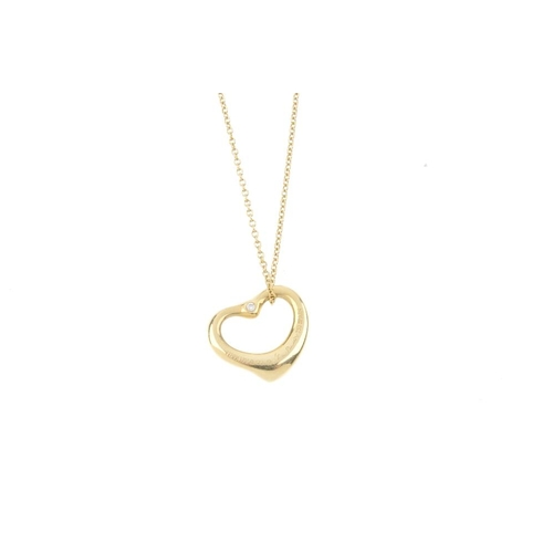 420 - TIFFANY & CO. - a 'open heart' pendant by Elsa Peretti for Tiffany & Co. The stylised heart, with br...