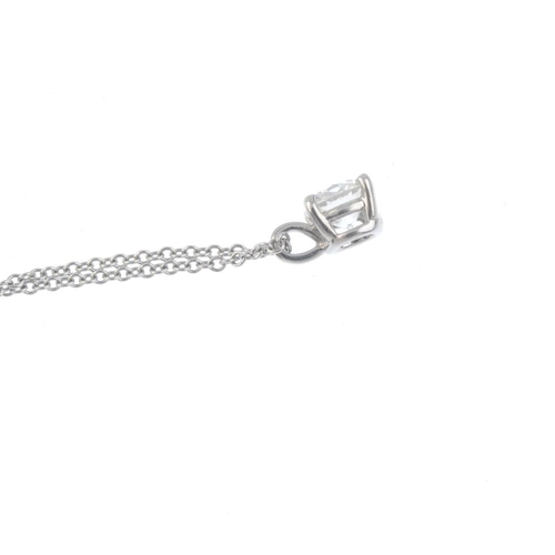 422 - TIFFANY & CO. - a platinum diamond single-stone pendant. The brilliant-cut diamond to the plain surm...