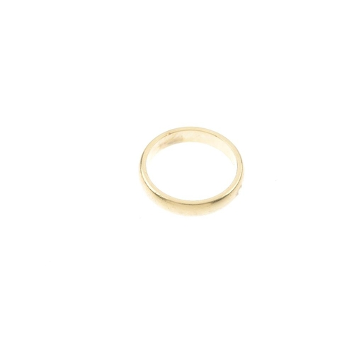 423 - TIFFANY & CO. - an 18ct gold band ring. Signed Tiffany & Co. Hallmarks for London. Ring size S. Weig...