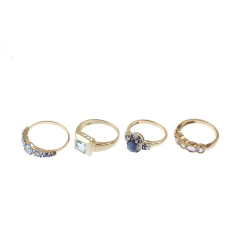 429 - Four 9ct gold gem-set rings. To include a sapphire and diamond ring, a blue topaz and amethyst five-...