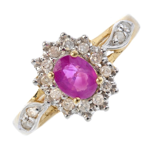 43 - A 9ct gold ruby and diamond cluster ring. The oval-shape ruby and brilliant-cut diamond cluster, wit...