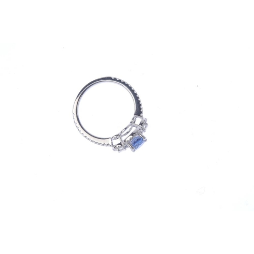 44 - A sapphire and diamond dress ring. The circular-shape sapphire and brilliant-cut diamond line, with ...