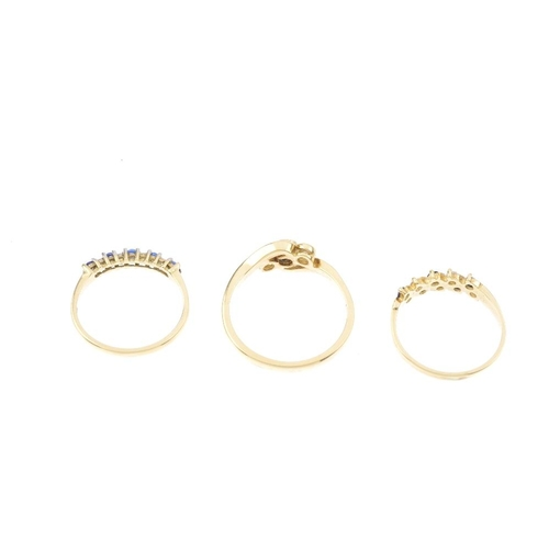 440 - Three 18ct gold sapphire and diamond rings. To include a sapphire and diamond three-stone crossover ...