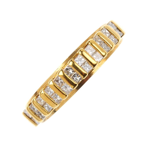 442 - An 18ct gold diamond band ring. Designed as a series of square-shape diamond duos, with bar spacers ...