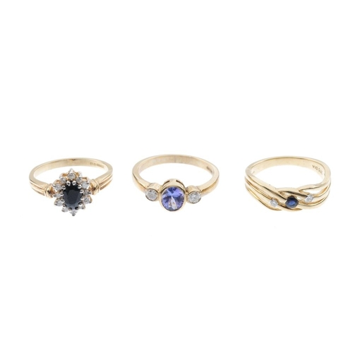 445 - Five 9ct gold diamond and gem-set rings. To include an tanzanite and diamond three-stone ring, a sap...