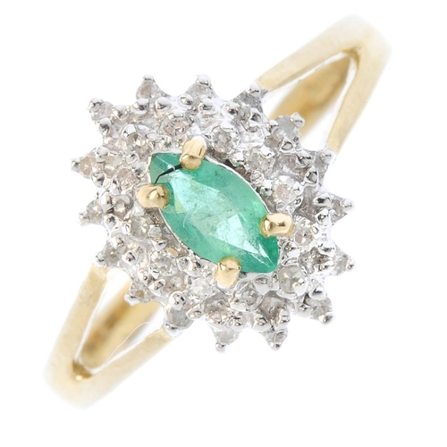 446 - A 9ct gold emerald and diamond cluster ring. The marquise-shape emerald, within a single-cut diamond...