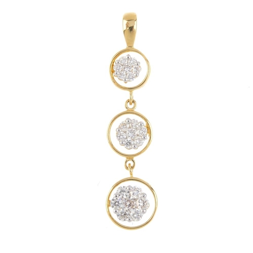 447 - An 18ct gold diamond pendant. Designed as a graduated series of brilliant-cut diamond floral cluster...