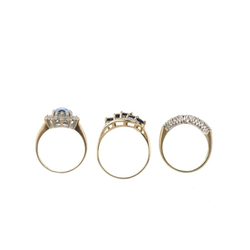 449 - Five 9ct gold diamond and gem-set rings. To include an aquamarine and diamond ring, a blue topaz and...