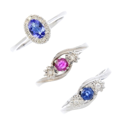450 - Three 9ct gold diamond and gem-set rings. To include a ruby and diamond three-stone crossover ring, ...