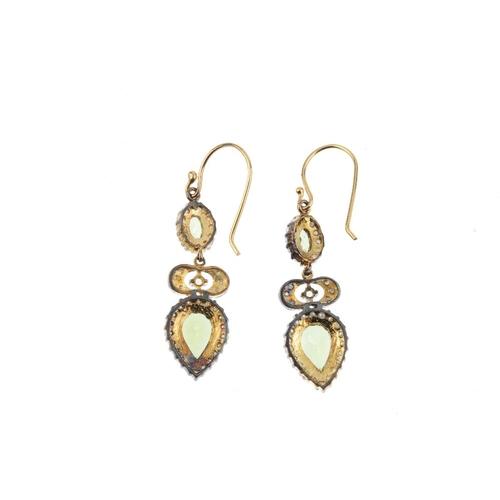 452 - A pair of peridot, split pearl and diamond earrings. Each designed as a pear-shape peridot and split...